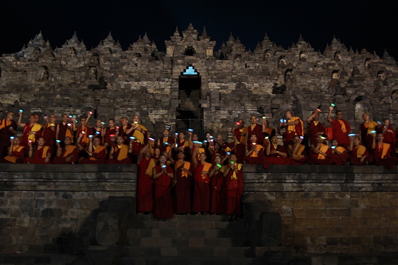Sangha offering the lamp at the Borobudur