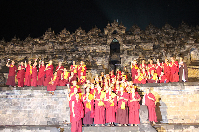 Sangha with lamp offering on the Borobudur
