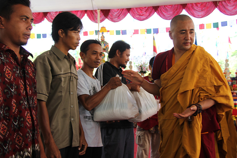Taklung Rinpoche give donation packet for poor people