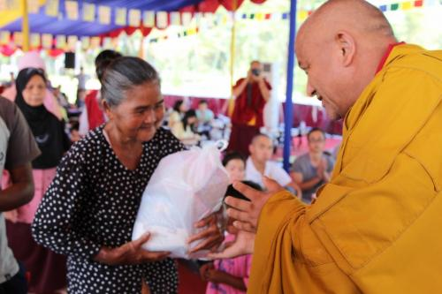 rinpoche give donation package to the poor people